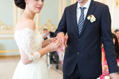 The newlyweds exchanged rings Royalty Free Stock Photo