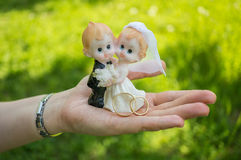 Newlyweds figurine of married couple in hand Stock Image