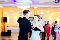 Newlyweds first dance on wedding party. Royalty Free Stock Images
