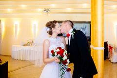 Newlyweds first kiss on wedding party. Wedding day Stock Photos