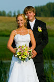 Newlyweds in formal pose stock image