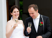 Newlyweds gining a toast Royalty Free Stock Photography