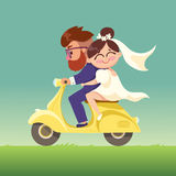 The newlyweds go on a moped. Stock Image