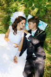 Newlyweds on grass Stock Photography