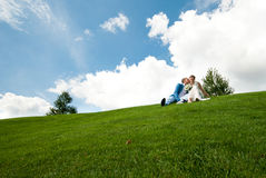 Newlyweds on a green lawn of background the sky Royalty Free Stock Photos