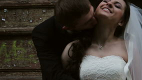 Newlyweds. groom kisses the bride stock footage