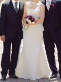 Newlyweds and Groomsman. Bride standing between groom and groomsman stock photography