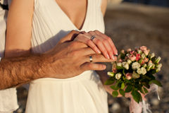 Newlyweds hands on the sunset Royalty Free Stock Image