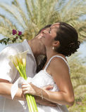 Newlyweds having a romantic kiss Stock Photography