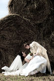 Newlyweds in the haystack Royalty Free Stock Photo
