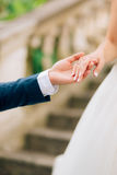 The newlyweds hold hands. Couple holding hands. Wedding in Monte Royalty Free Stock Photo