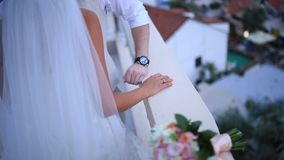 The newlyweds hold hands at the wedding ceremony. Couple holding stock video