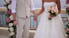 The newlyweds hold hands at the wedding ceremony. Couple holding. Hands. Wedding in Montenegro stock footage