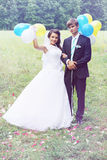 Newlyweds holding balls Royalty Free Stock Image