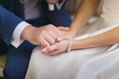 Newlyweds holding Hand in hand Royalty Free Stock Images