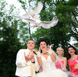 Newlyweds holding white doves Royalty Free Stock Images