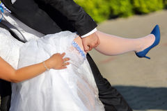 Newlyweds in hug sunny shine outdoors Stock Photography