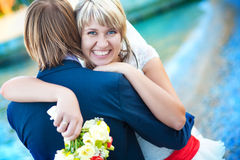 Newlyweds are hugging on the beach Royalty Free Stock Photo
