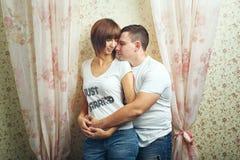 Newlyweds hugging. Happy newlyweds hugging T-shirts, shot in the studio Royalty Free Stock Image