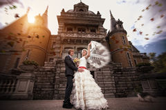 Newlyweds are hugging near the ancient castle Stock Images