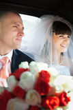 Newlyweds inside a car Royalty Free Stock Photo