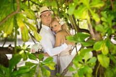 Newlyweds on island Stock Images