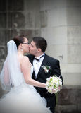 Newlyweds kiss. Newlyweds loving couple kiss outdoors Stock Photo