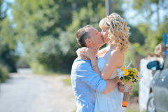 Newlyweds kiss on nature Stock Photo