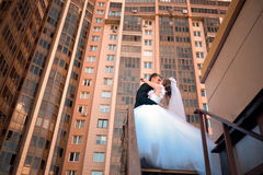 Newlyweds kiss on the stairs Stock Photography
