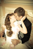 Newlyweds kiss in wedding palace Royalty Free Stock Photos