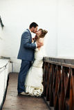 Newlyweds kissing Stock Photo