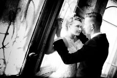 Newlyweds kissing near old door Stock Image