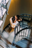 The newlyweds are kissing on the stairs. The above view. The newlyweds are kissing on the stairs. The above view Stock Images