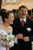 Newlyweds laughing Royalty Free Stock Photo