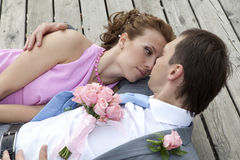Newlyweds laying down on the wood floor Royalty Free Stock Images