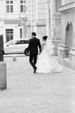Newlyweds leaving the town square Stock Photo