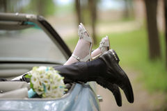 Newlyweds' Legs in a Car Royalty Free Stock Images