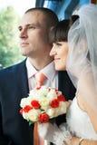 Newlyweds looking ahead Royalty Free Stock Photos