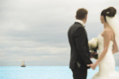 Newlyweds are looking into the distance. Royalty Free Stock Image