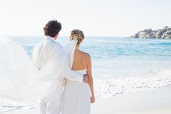 Newlyweds looking out to the sea together Stock Photography