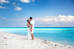 Newlyweds in love on white sandy beach Stock Image
