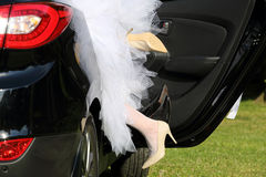 Newlyweds loving in the car after wedding ceremony Royalty Free Stock Images
