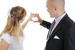 Newlyweds make heart fingers Royalty Free Stock Photos