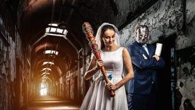 Newlyweds maniacs, old prison on background Stock Image