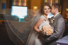 Newlyweds in the modern hotel hall Stock Images