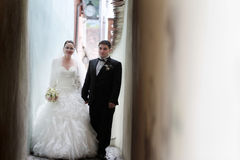 Newlyweds on narrow street Royalty Free Stock Photography