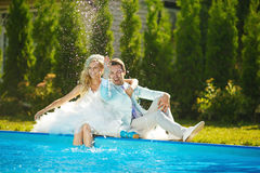 Newlyweds near water Stock Images