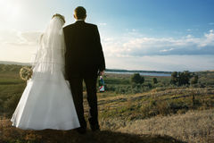 Newlyweds outdoors at dawn Royalty Free Stock Image