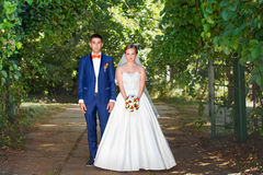 Newlyweds outdoors Royalty Free Stock Photos