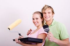 Newlyweds painting home Royalty Free Stock Photo
